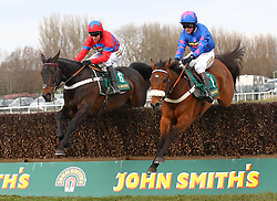 Sprinter Sacre and Barry Geraghty [left] win the John Smith's Melling Chase at Aintree from Cue Card, Aintree Racecourse, Aintree, Merseyside, England. April 5, 2013. Photo by Racingfotos.com / i-Images...
