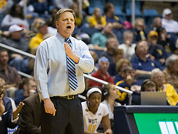 West Virginia Mountaineers head coach Mike Carey calls out a play against the Oklahoma Sooners during the second half at the WVU Coliseum.