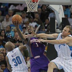 03 December 2008:  Phoenix Suns forward Amare Stoudemire (1) shoots between Hornets defenders David West (30) and Sean Marks (4) during a 104-91 victory by the New Orleans Hornets over the Phoenix Suns at the New Orleans Arena in New Orleans, LA..