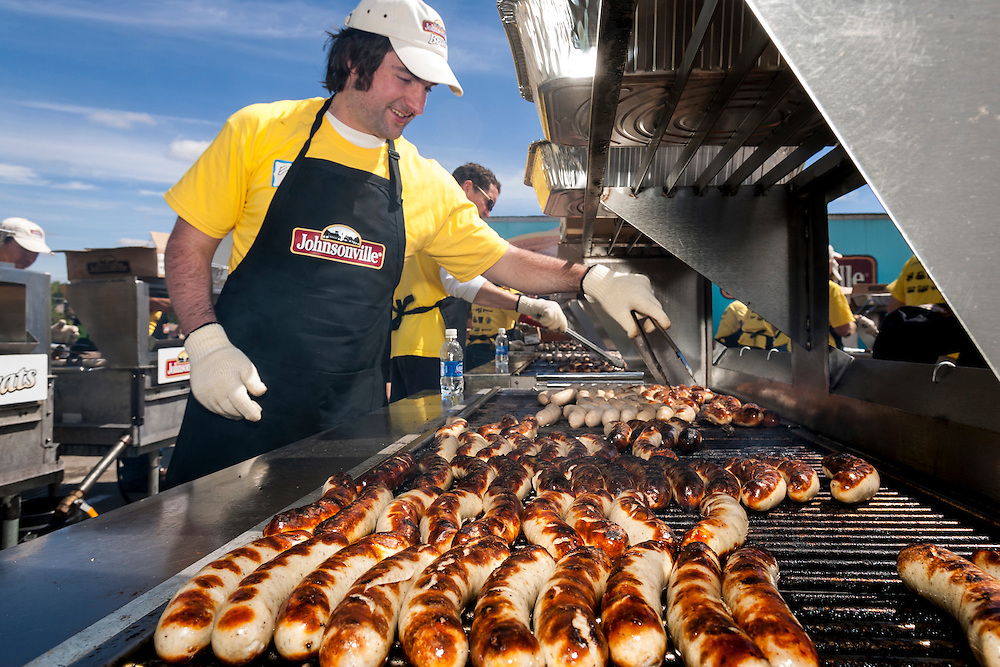 Volunteers cook bratwursts for about 100,000 people for the annual Brat Fest over the Memorial Day weekend in Madison, Wis. About 100 brats will be eaten each minute.(Photo © Andy Manis)