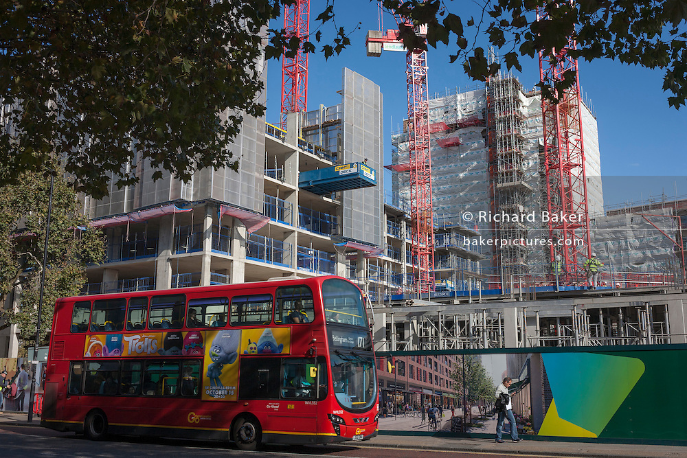 A London bus pases the new Elephant Park development on the Walworth Road, at Elephant & Castle, London borough of Southwark. Southwark Council's development partner, Lendlease is regenerating over 28 acres across three sites at the heart of Elephant & Castle, in what is the latest major regeneration opportunity in zone 1 London. The vision for the £1.5 billion regeneration is to build on the area's strengths and vibrant character in order to re-establish Elephant & Castle as one of London's most flourishing urban quarters. The Elephant & Castle regeneration is of a scale rarely seen in central London and includes almost 3,000 new homes, plus office, retail, community, leisure and restaurant space.