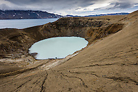Víti explosion crater, on the north east shore of Lake Askja - Öskjuvatn. The lake covers the Caldera of Askja Stratovolcano. Víti is approximately 150 metres diameter. It contains a geothermal lake of mineral-rich, sulphurous, opaque blue water, which is maintained at a comfortable temperature for swimming.