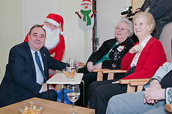 First Minister Alex Salmond, accompanied by Santa Clause, visited the Dean Club in Stiockbridge Edinburgh today to distribute Christmas presenets to the residents (c) GER HARLEY | StockPix.eu
