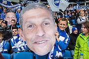 An Albion fan with a giant head of Brighton Manager Chris Hughton during the Sky Bet Championship match between Brighton and Hove Albion and Derby County at the American Express Community Stadium, Brighton and Hove, England on 2 May 2016. Photo by Bennett Dean.