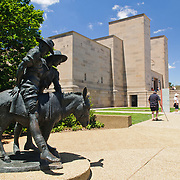 "Statue of Simpson and his Donkey at the Australian War Memorial in Canberra, ACT, Australia. John (Jack) Simpson Kirkpatrick (6 July 1892–19 May 1915 aged 23) was a stretcher bearer with the Australian and New Zealand Army Corps during the Gallipoli Campaign, in World War I. After landing at Anzac Cove on 25 April 1915, he obtained a donkey and began carrying wounded British Empire soldiers from the frontline to the beach, for evacuation. He continued this work for three and a half weeks, often under fire, until he was killed. Simpson and his Donkey are a key part of the ""Anzac legend"". He joined the army so that he might be sent back to England to fight for his own country."