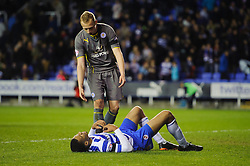 Michael Hector (ENG) of Reading looks dejected on the floor as Daniel Drinkwater (ENG) of Leicester City stands over him after the match finishes in a 1-1 draw - Photo mandatory by-line: Rogan Thomson/JMP - 07966 386802 - 14/04/2014 - SPORT - FOOTBALL - Madejski Stadium, Reading - Reading v Leicester City - Sky Bet Football League Championship.