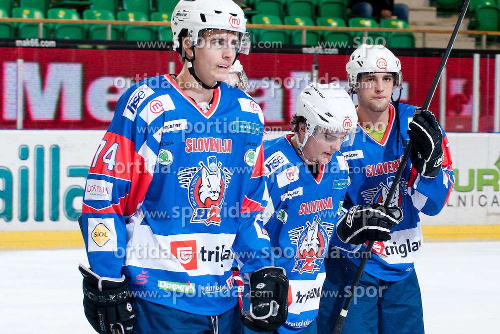 Miha Verlic, Andrej Zidan and Ziga Pance of Slovenia at ice-hockey match between Slovenia and Kazakhstan, on April 12, 2011 at Hala Tivoli, Ljubljana, Slovenia. (Photo By Matic Klansek Velej / Sportida.com)