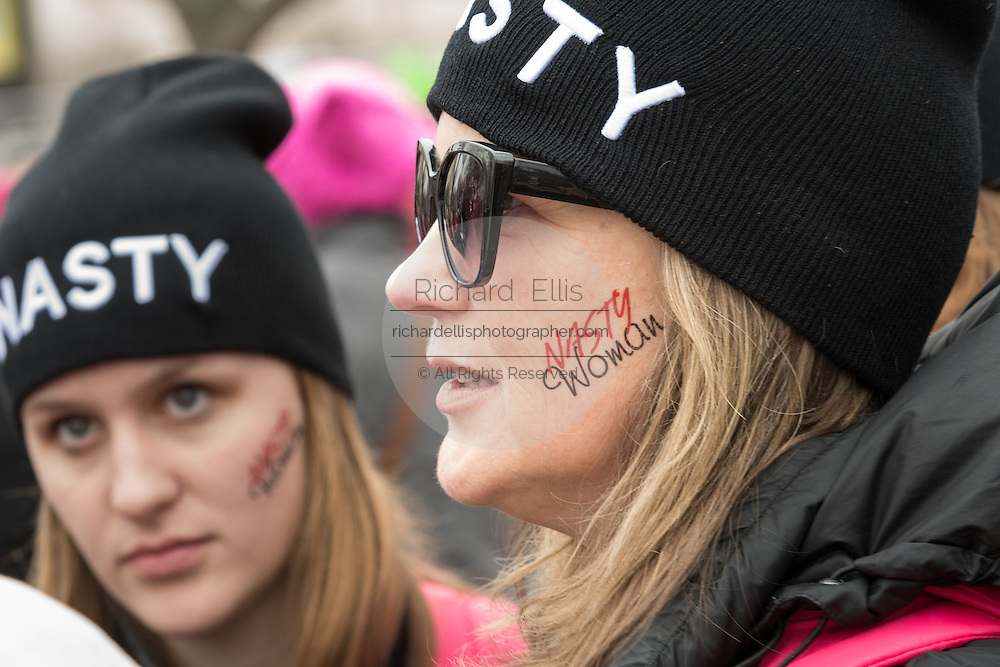 Women wearing Nasty Woman tattoos on their face during the Women's March on Washington in protest to President Donald Trump January 21, 2017 in Washington, DC. More than 500,000 people crammed the National Mall in a peaceful and festival rally in a rebuke of the new president.