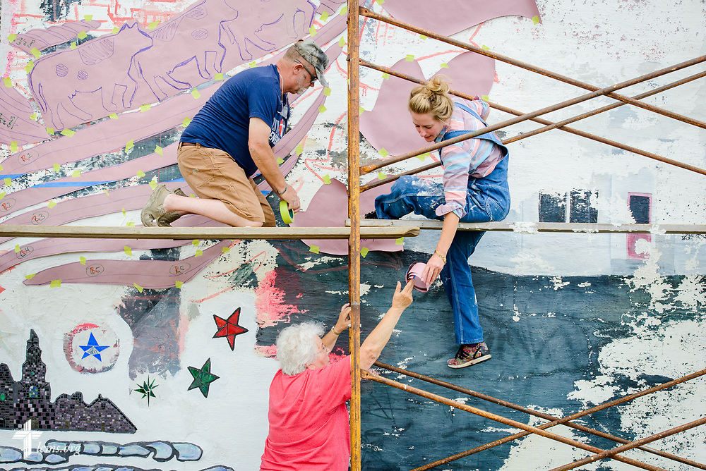 Artist Rachel Ziegler works on her mural project commemorating the 500th anniversary of the Lutheran Reformation with Marilyn Bader and Tim Morthole on the building across from Zion Lutheran Church, Worms, Neb., on Saturday, Sept. 23, 2017. LCMS Communications/Erik M. Lunsford