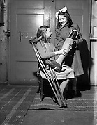 """23/12/1952<br /> 12/23/1952<br /> 23 December 1952<br /> Monica Clarke receives  artificial limb (leg) from the """"Vangang"""" at Smith and Sheppard Surgical and Medical Appliances, St. Stephen's Green, Dublin."""