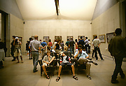 Image of tired tourists and visitors viewing art inside the Musee D'Orsay in Paris, France