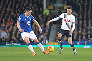Everton midfielder Gareth Barry flicks the ball away from Tottenham Hotspur midfielder Dele Alli during the Barclays Premier League match between Everton and Tottenham Hotspur at Goodison Park, Liverpool, England on 3 January 2016. Photo by Simon Davies.