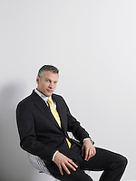 Businessman Sitting in Swivel Chair