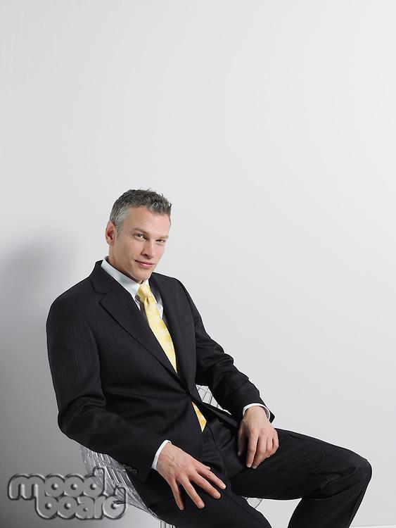 Businessman Sitting in Swivel Chair