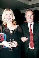 Rob Dickins CBE receives the Music Industry Trust's Award at the Grosvenor Hotel London.<br /> Presented to him by Rod Stewart.