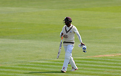 Dejection for Surrey's Kumar Sangakkara as he is dismissed for 149. - Photo mandatory by-line: Harry Trump/JMP - Mobile: 07966 386802 - 20/04/15 - SPORT - CRICKET - LVCC County Championship - Division 2 - Day 2 - Glamorgan v Surrey - Swalec Stadium, Cardiff, Wales.