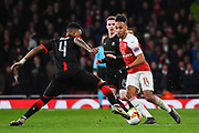 Arsenal Forward Pierre-Emerick Aubameyang (14) and Rennes Mexer (4) in action during the Europa League round of 16, leg 2 of 2 match between Arsenal and Rennes at the Emirates Stadium, London, England on 14 March 2019.