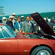 Andy Granatelli shows off the Studebaker Avanti's R3 engine at the Indianapolis Press Preview in October of 1962. Automotive journalist Denise McCluggage is standing next to Granantelli.