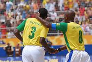 Football-FIFA Beach Soccer World Cup 2006 - Semi-final -BRA_POR -Junior Negão congratulates his team-mate Bueno after a goal scored by him-BRA- Rio de Janeiro - Brazil 11/11/2006<br />Mandatory credit: FIFA/ Marco Antonio Rezende.