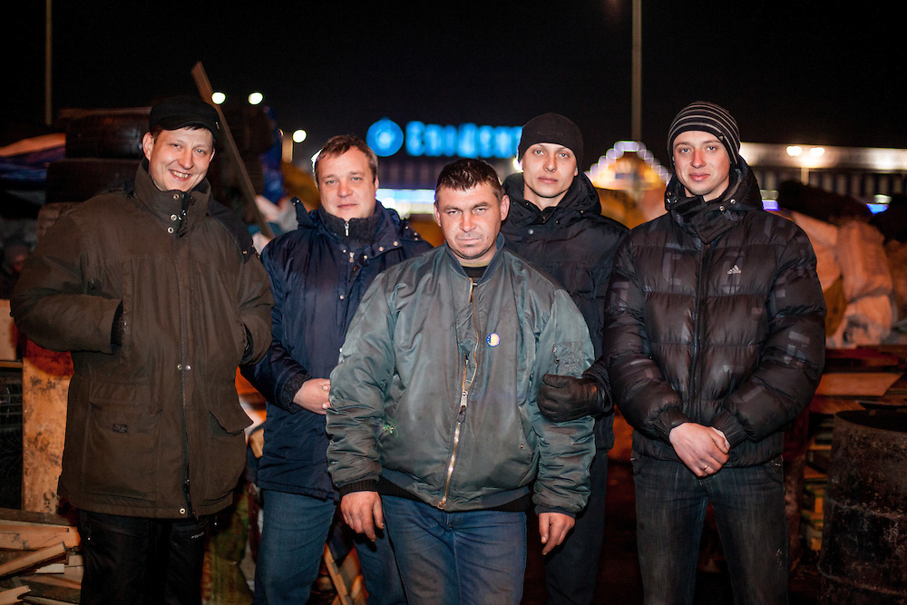 "The core group of activists from left Oleg, Dimi, ""Bosch"", Andrej and his brother in front of the Barrikades blocking a building supplies store named ""Epicenter"" in the city of Lviv, Ukraine."