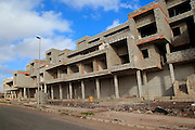 Concrete shells of uncompleted housing in the Castillo development, Caleta de Fuste,  Fuerteventura, Canary Islands, Spain