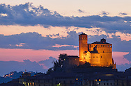 The 11th century Serralunga castle is illuminated against a sunset sky in the Piedmont region of Italy.  The hilltop village of Serralunga is near Barolo. http://www.gettyimages.com/detail/photo/serralunga-castle-piedmont-region-italy-high-res-stock-photography/114261399