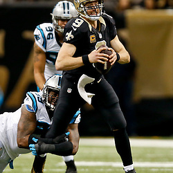 Dec 7, 2014; New Orleans, LA, USA; New Orleans Saints quarterback Drew Brees (9) is brought down by Carolina Panthers defensive tackle Kawann Short (99) during the first half of a game at the Mercedes-Benz Superdome. Mandatory Credit: Derick E. Hingle-USA TODAY Sports