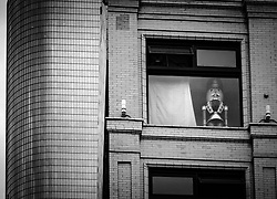 A nutcracker statue peers out a window in the 300 block of  South Broadway at West 4th St. in downtown Los Angeles. Modern building to the left is the California Plaza skyscraper.