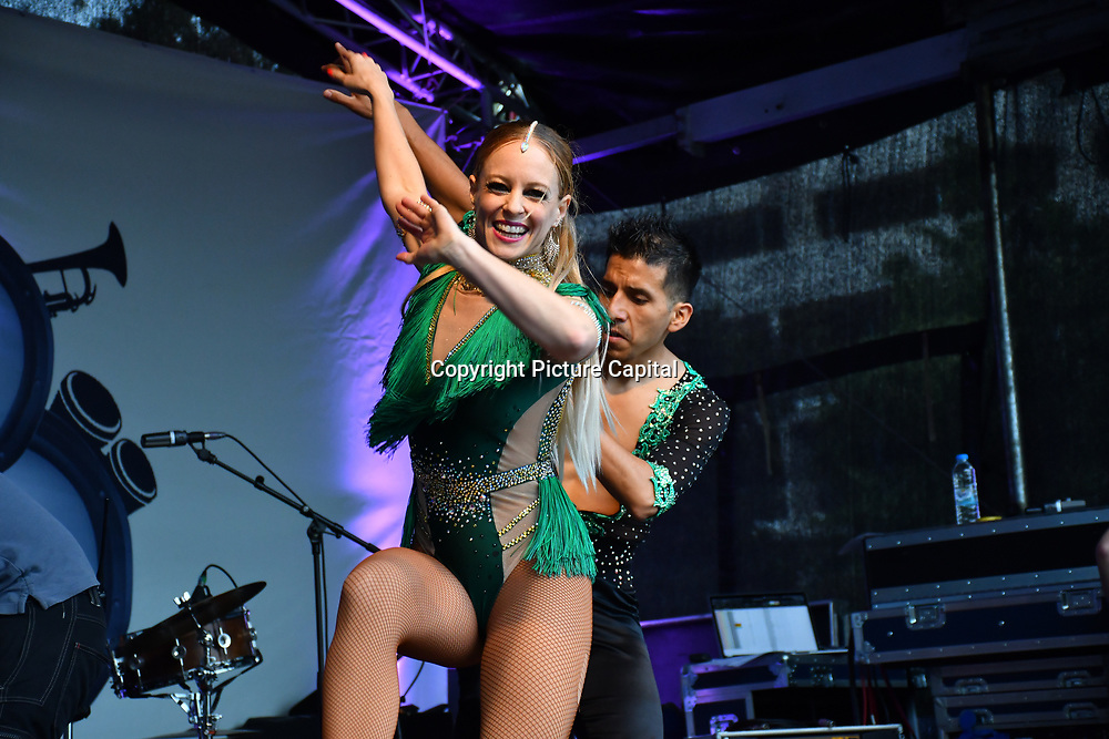 Eddie and Kat of Latin Fun Machine FM performs at the La Clave Fest 2019: Free Latin Festival in London with live performances great food and drinks and beautiful people at Finsbury park on 3 August 2019, London, UK.