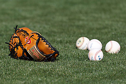 OAKLAND, CA - AUGUST 02: General view of a baseball glove and baseball on a grassy field before the game between the Oakland Athletics and the Toronto Blue Jays at O.co Coliseum on August 2, 2012 in Oakland, California. The Oakland Athletics defeated the Toronto Blue Jays 4-1. (Photo by Jason O. Watson/Getty Images) *** Local Caption ***