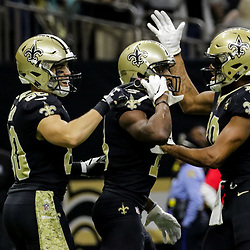 Nov 4, 2018; New Orleans, LA, USA; New Orleans Saints wide receiver Michael Thomas (13) pulls out a cell phone to celebrate a touchdown along with teammates wide receiver Austin Carr (80) and wide receiver Tre'Quan Smith (10) during the fourth quarter against the Los Angeles Rams at the Mercedes-Benz Superdome. Mandatory Credit: Derick E. Hingle-USA TODAY Sports