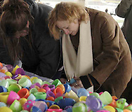Kiana Burnett, from Dayton (left) and Annette McKinley, from Fairborn find out what's in eggs that were collected in an Easter egg hunt..