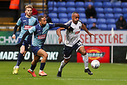 Bolton Wanderers forward Chris O'Grady tackled by the opponent during the EFL Sky Bet League 1 match between Bolton Wanderers and Wycombe Wanderers at the University of  Bolton Stadium, Bolton, England on 15 February 2020.
