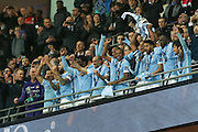Manchester City  lift the cup during the Capital One Cup match between Liverpool and Manchester City at Anfield, Liverpool, England on 28 February 2016. Photo by Simon Davies.
