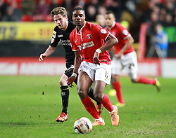 Charlton Athletic's Jonathan Obika on his return to The Valley passes the ball under pressure from Bournemouth's Eunan O'Kane  - Photo mandatory by-line: Robin White/JMP - Tel: Mobile: 07966 386802 18/03/2014 - SPORT - FOOTBALL - The Valley - Charlton - Charlton Athletic v Bournemouth - Sky Bet Championship