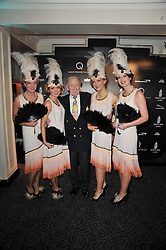 LESLIE PHILLIPS and guests at Quintessentially's 10th birthday party held at The Savoy Hotel, London on 13th December 2010.