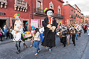 Rachel Navejar and Edward Phillips celebrate their wedding with a procession during the Day of the Dead festival in the Jardin Principal October 28, 2016 in San Miguel de Allende, Guanajuato, Mexico. The week-long celebration is a time when Mexicans welcome the dead back to earth for a visit and celebrate life.