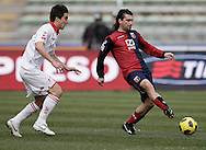 Bari (BA), 13-02-2011 ITALY - Italian Soccer Championship Day 25 - Bari VS Genoa..Pictured: Bentivoglio (BA) Kaladze (GE).Photo by Giovanni Marino/OTNPhotos . Obligatory Credit