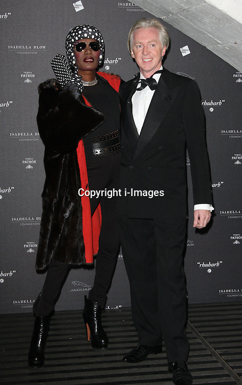 Grace Jones and Philip Treacy  arriving at the opening of the  Isabella Blow at the Isabella Blow exhibition at Somerset House in London, Tuesday, 19th November 2013   Photo by: i-Images