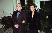 Actor Robert Duvall and his friend Luciana Pedraza arrive for the State Dinner for Argentine President Carlos Menem January 11, 1999 at the White House.