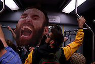 June 18, 2011, Boston, MA - A fan carries a giant cut out of the head of Zdeno Chara while on the train to the parade to celebrate the Boston Bruins 2011 Stanley Cup Championship. Photo by Lathan Goumas.