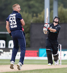 New Zealand's Tom Latham, right, is resigned to being caught out off the bowling of England's Tom Curran in the fourth one day cricket international at the University of Otago Oval, Dunedin, New Zealand, Wednesday, March 7, 2018. Credit:SNPA / Adam Binns ** NO ARCHIVING**
