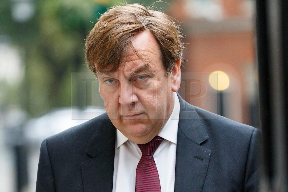 © Licensed to London News Pictures. 13/10/2015. London, UK. Culture Secretary JOHN WHITTINGDALE leaving Downing Street after a cabinet meeting on Tuesday, 13 October 2015. Photo credit: Tolga Akmen/LNP
