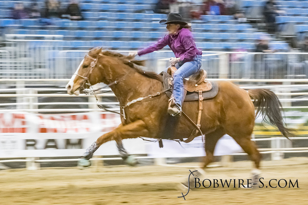 Barrel racer Cathy Roesler makes her run during slack at the Bismarck Rodeo on Saturday, Feb. 3, 2018. She had a time of 13.07 seconds. This photo and more from most runs are available at Bobwire-S.com.