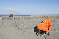 Adding machine and orange chair, Salton Sea Beach, California