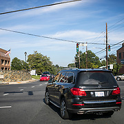 Two Mercedes SUVs turn left onto Falls Rd. from River Rd. in Potomac, Maryland going from Maryland's 6th Congressional district to the 8th, on Tuesday, September 26, 2017. Maryland's 6th District was redistricted in 2011, combining rural northern Maryland regions with more affluent communities like Potomac and Germantown. <br /> CREDIT: John Boal for The Wall Street Journal<br /> GERRYMANDER