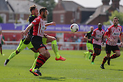 forward Jake Hyde challenges defender Jamie McAllister  during the Sky Bet League 2 match between Exeter City and York City at St James' Park, Exeter, England on 22 August 2015. Photo by Simon Davies.
