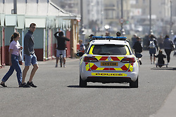 © Licensed to London News Pictures. 23/05/2020. Brighton, UK. Police patrol the sea front at Hove in West Sussex. The government has announced a series of measures to slowly ease lockdown, which was introduced to fight the spread of the COVID-19 strain of coronavirus. Photo credit: Peter Macdiarmid/LNP