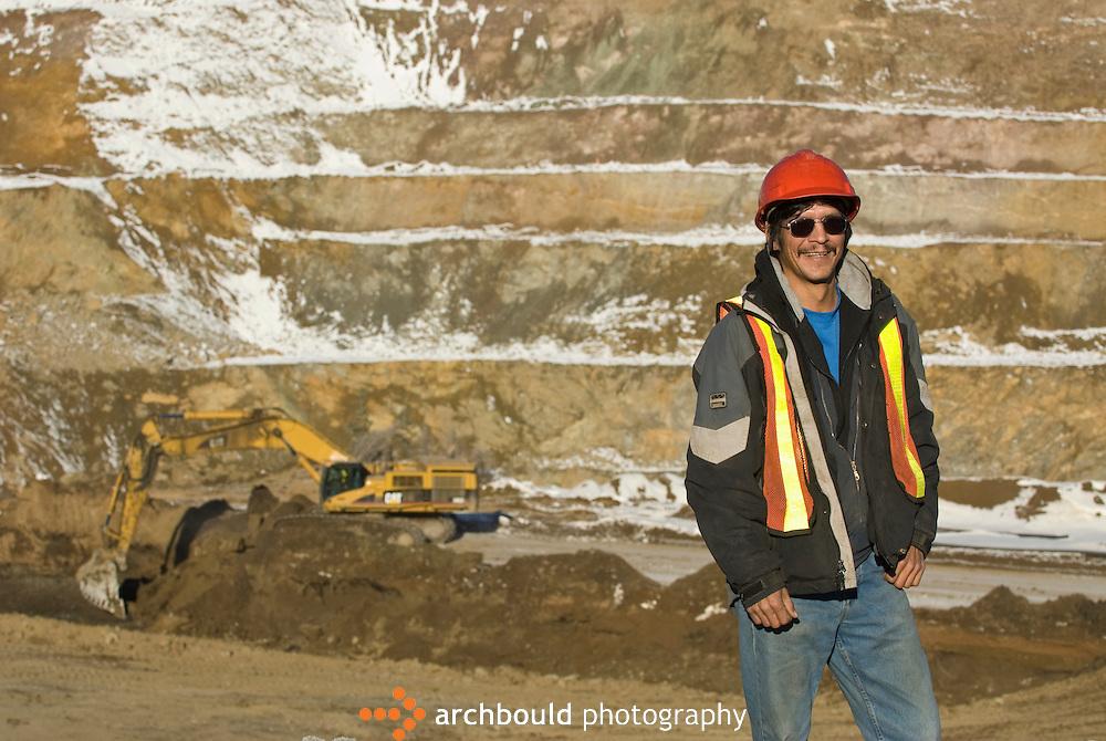 Miner at open pit mine in northern Yukon.