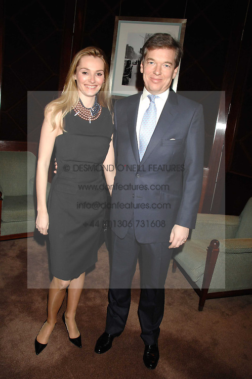 CHARLIE BUTTER and his wife AGNIESZKA at a party to celebrate the publication of Top Tips For Girls by Kate Reardon held at Claridge's, Brook Street, London on 28th January 2008.<br /><br />NON EXCLUSIVE - WORLD RIGHTS